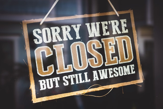 sorry we're closed sign in a business